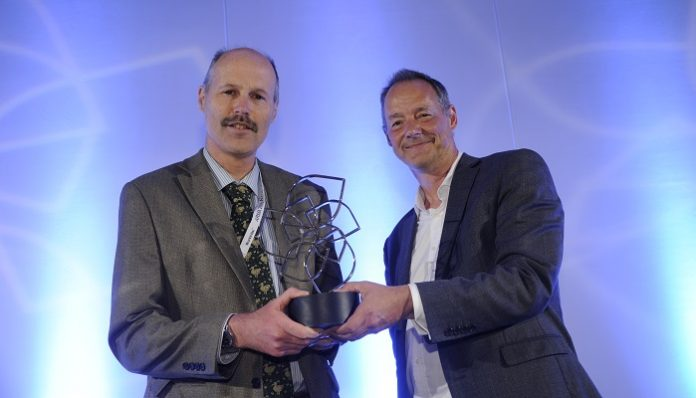 Glenn Swafford (left) receiving his ARMA Award for outstanding contribution to research management and administration from the Leadership Foundation for Higher Education's Paul Gentle